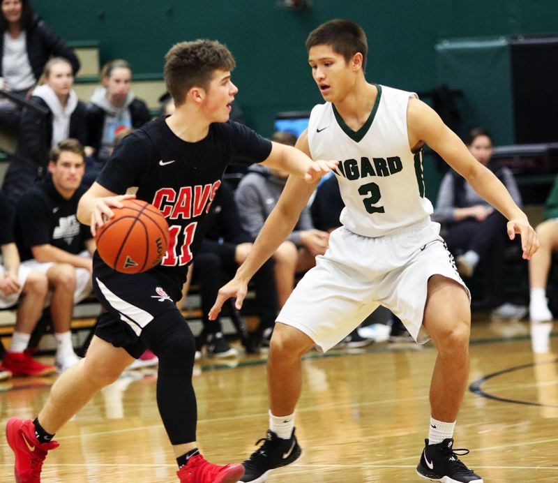TIMES PHOTO: DAN BROOD - Tigard senior Jazz Ross (right) keeps the pressure on Clackamas junior Artur Gavrilovich.