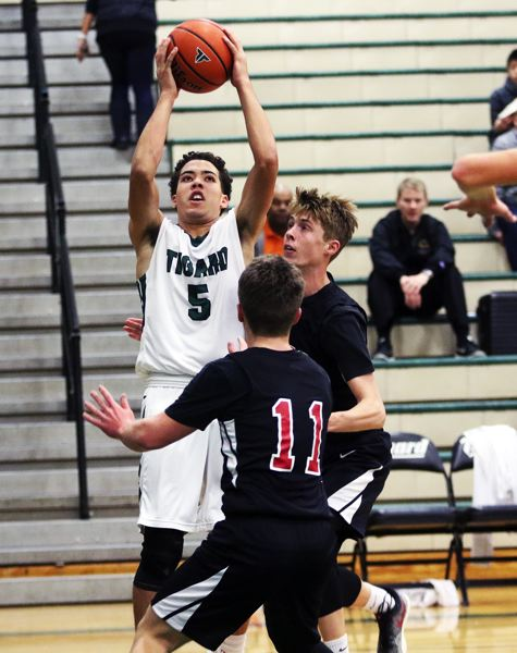 TIMES PHOTO: DAN BROOD - Tigard sophomore Drew Carter goes up for a shot during the Tigers' game with Clackamas.