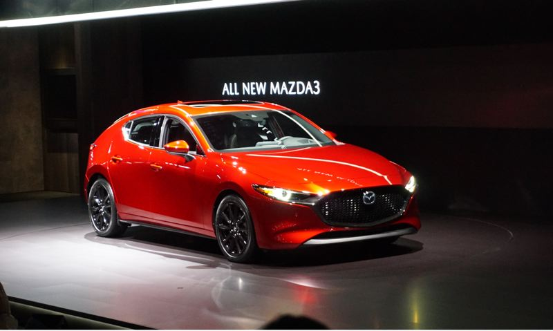 PORTLAND TRIBUNE: JEFF ZURSCHMEIDE - The 2019 Mazda3 hatchback has a rounded rear end similar to older fastback sports cars. It is also available as a stylish sedan.