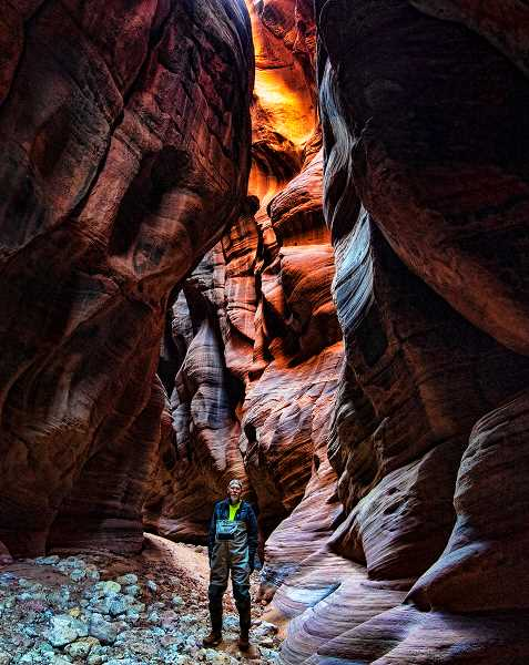 LON AUSTIN/CENTRAL OREGONIAN - The author stands in the shadows of one of the taller portions of the canyon. Buckskin Gulch is considered to be the longest slot canyon in the world.