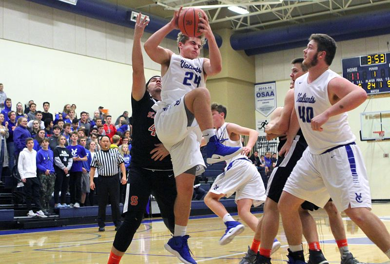 PAMPLIN MEDIA GROUP PHOTO: MILES VANCE - Valley Catholic sophomore Will French rips down a rebound during his team's 80-35 win over Scappoose on Nov. 28 at Valley Catholic High School.