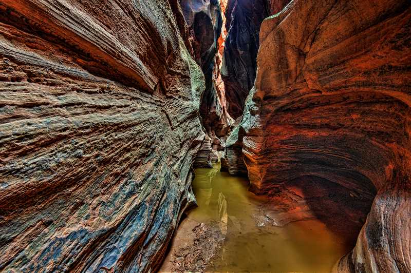 LON AUSTIN/CENTRAL OREGONIAN - A series of pools midway through the canyon named the cesspools contain stagnant, sometimes deep water, just one of many obstacles in the canyon.