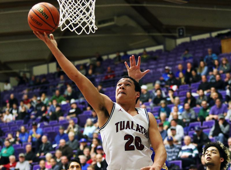 TIMES FILE PHOTO: DAN BROOD - Tualatin junior John Miller is a returning starter from last years Timberwolf state tournament team.