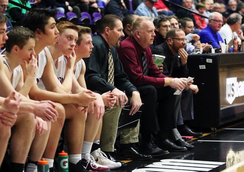 TIMES FILE PHOTO: DAN BROOD - Todd Jukkala (black shirt) takes over as the new Tualatin boys basketball varsity head coach this season.