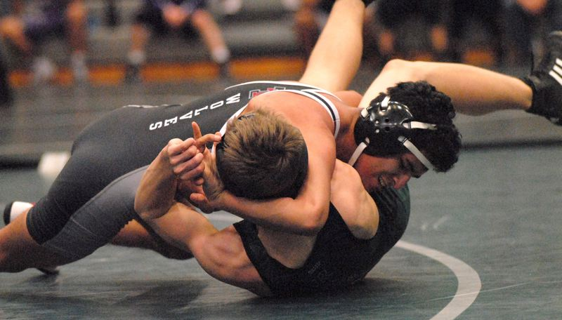PMG PHOTO: DAVID BALL - Tualatin senior Argenys Abarca-Lopez goes for a pin during action at the Kirk Morey Invitational on Friday.