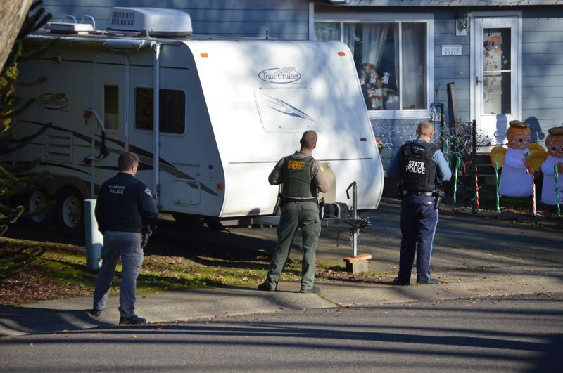 SPOTLIGHT PHOTO: NICOLE THILL-PACHECO - Law enforcement officers respond to a 911 call reported at a home on Southwest Meadow Drive on Tuesday, Dec. 4. Officers determined the call was a hoax and there was no threat to the public.