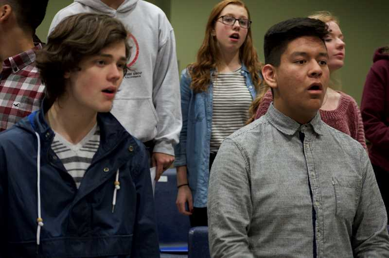 SPOKESMAN PHOTO: CLARA HOWELL  - Casey Young, from left, Annabelle McClelland and Sam Duran practice during a WHS choir rehearsal.