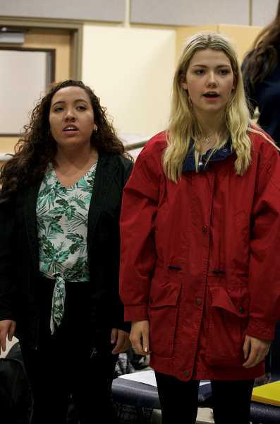 SPOKESMAN PHOTO: CLARA HOWELL  - Rachelle Aguilar, left, and Natalie Young practice during a WHS choir rehearsal.