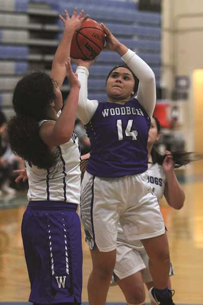 PHIL HAWKINS - Woodburn's Jocelyn Santillan pulls up for a jumper over teammate Tatiana Garcia in the Bulldogs' blue and white scrimmage on Nov. 27 prior to the team's season opener, a 56-51 loss at Tillamook the following night.