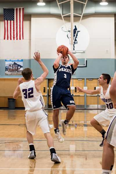SUBMITTED PHOTO: GREG ARTMAN - Senior Jack Roche set the school record for assists in a single game against Ridgeview with 18. That, combined with 26 points, helped lead Wilsonville to a lopsided 103-43 score.