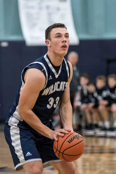 SUBMITTED PHOTO: GREG ARTMAN - Senior Nolan Thebiay led the team in rebounds against Ridgeview with 11 boards, and also contributed 12 points in that blowout win.