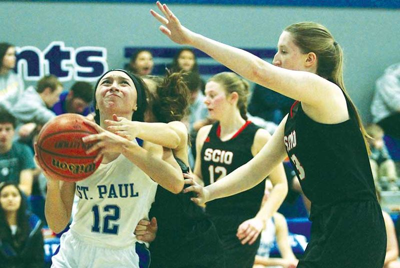 PHIL HAWKINS - WOODBURN INDEPENDENT - St. Paul junior Diana Hernandez drives through contact in a 77-13 win over Scio on Thursday.