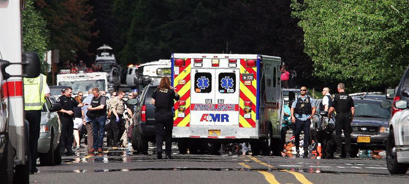 FILE PHOTO - Police and emergency crews arrive at Reynolds High School following a June 2015 shooting. Violence and the threat of violence at schools has become far too normalized, with two school shootings in the United States to date this year that left at least 10 dead.