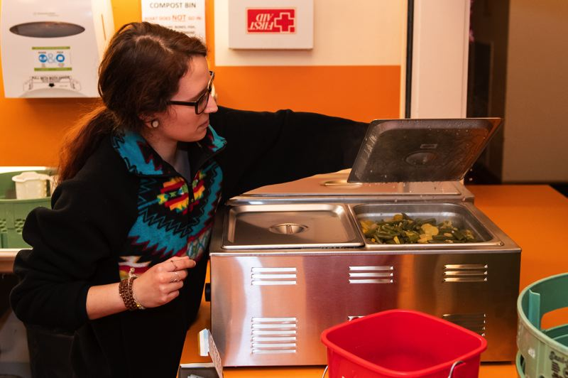 STAFF PHOTO: CHRISTOPHER OERTELL - Victoria Wingell displays a hot tray of green beans at the homeless shelter at the Forest Grove United Church of Christ.