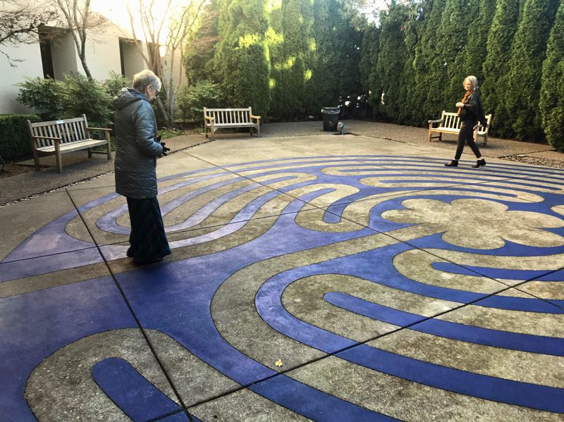 TIMES PHOTO: DANA HAYNES - Walkers Donna Vande Kieft, left, and Debbie Burchfiel slowly walk the labyrinth near the north entrance of Legacy Meridian Park Medical Center.