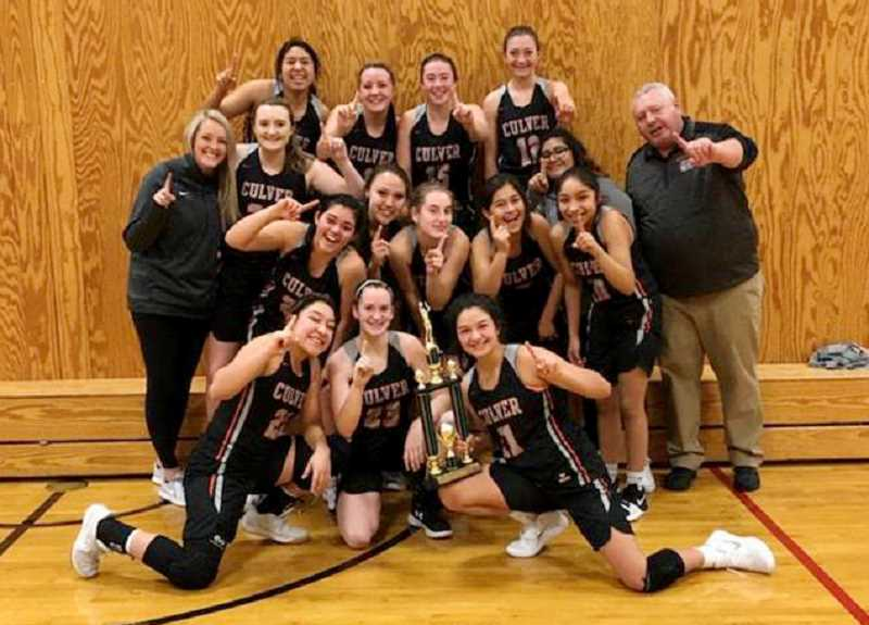 SUBMITTED PHOTO - The Culver Bulldogs girls basketball team poses with their first-place trophy after winning a tournament in Sherman County. CHS beat Stanfield 49-24 and Grant Union 41-39.