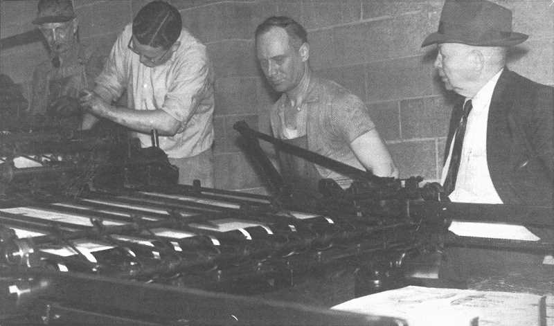 FILE PHOTO - Longtime Woodburn Independent publisher Gene Stoller, center, works at the press in the 1950s.