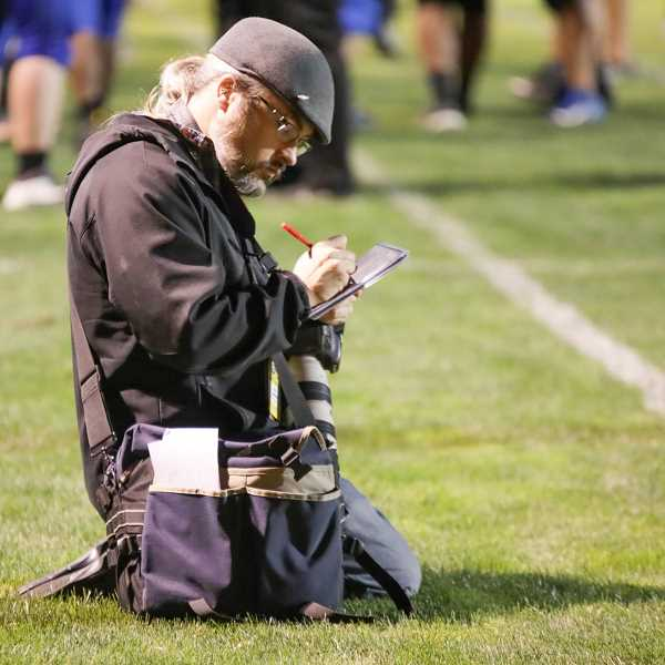 COURTESY PHOTO: RICK VASQUEZ - Phil Hawkins, Woodburn Independent schools and sports reporter, works on the sidelines at a sporting event.