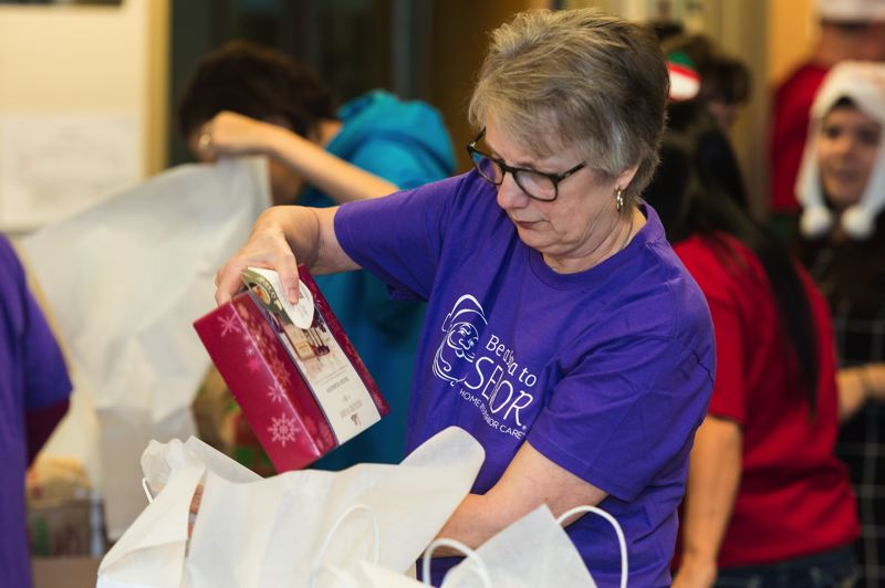 STAFF PHOTO: CHRISTOPHER OERTELL - During last year's Be a Santa to a Senior event, the Home Instead Hillsboro franchise provided gifts to 375 seniors. This year, nearly twice as many will receive gifts.
