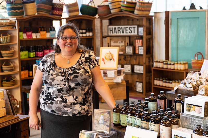 STAFF PHOTO: CHRISTOPHER OERTELL - EJ Payne, director of the Hillsboro Downtown Parntership has launched a new popup business selling holiday gifts through Dec. 30.