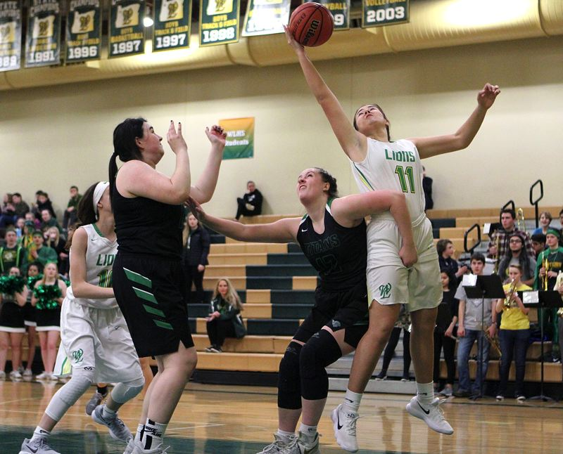 TIDINGS FILE PHOTO - West Linn's Vanessa Viukhola and the Lions are ranked eighth in the latest Class 6A girls basketball coaches poll.
