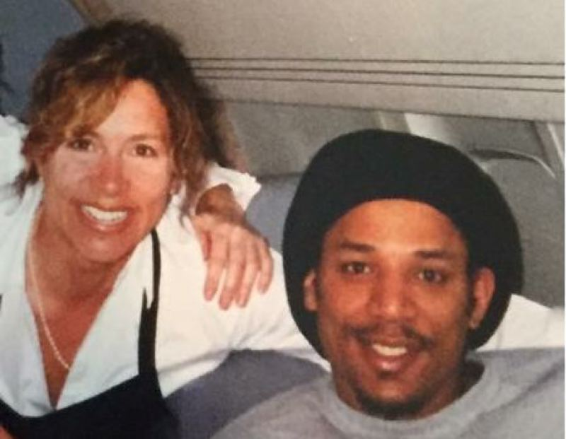 COURTESY: STEPHANIE SMITH-LECKNESS - During her time as flight attendant with the Trail Blazers, Stephanie Smith-Leckness shares a smile with Portland forward Brian Grant.