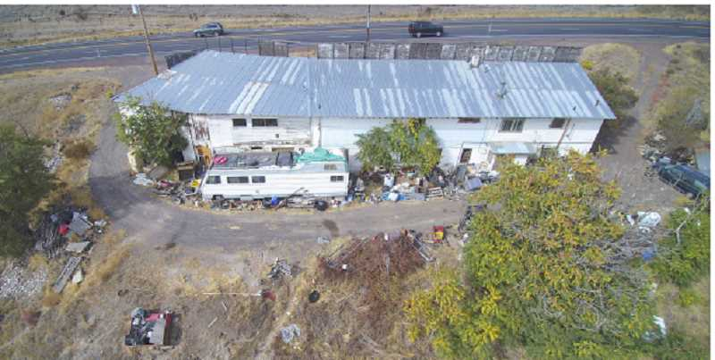 PHOTO BY TOM BROWN - The city of Madras is planning to purchase the old rock shop property from the Department of Justice, and work with the county to clean it up.