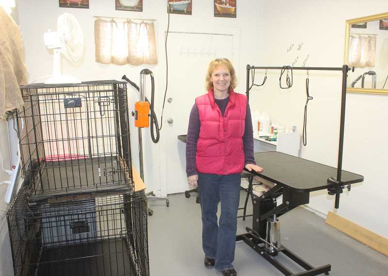 SUSAN MATHENY/MADRAS PIONEER - Owner Michal Smith shows her shop's new dog grooming facility.
