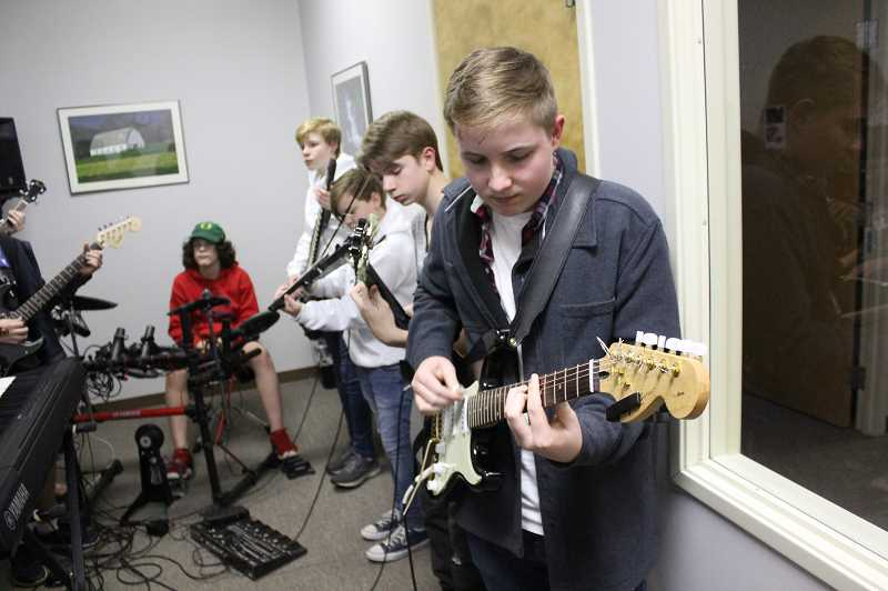 SPOKESMAN PHOTOS: COREY BUCHANAN - Guitarist Carter Schnell (front) is a member of the Zero South, one of three bands that will compete in the Concert School of Musics eXtraordinary League of Rockers Battle of the Bands.