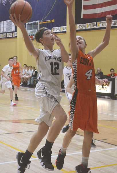 PIONEER PHOTO: TANNER RUSS - Country Christian freshman Judah Syphard is one of a large group of freshman to come into the basketball program, and is one of a handful that swings up to the varsity roster.