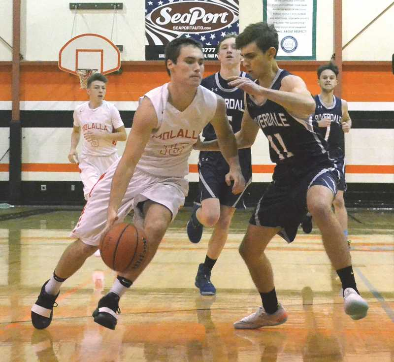 PIONEER PHOTO: TANNER RUSS - Molalla senior Brice Sperl drives to the basket against Riverdale in the teams season opener. Molalla ended up losing the contest 58-45.