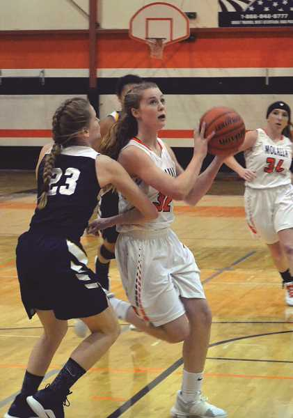 PIONEER PHOTO: TANNER RUSS - Molalla freshman Ruby Burge moves through the Country Christian defense into the paint in the home opener. Molalla wound up winning 63-21 at the end of the night.