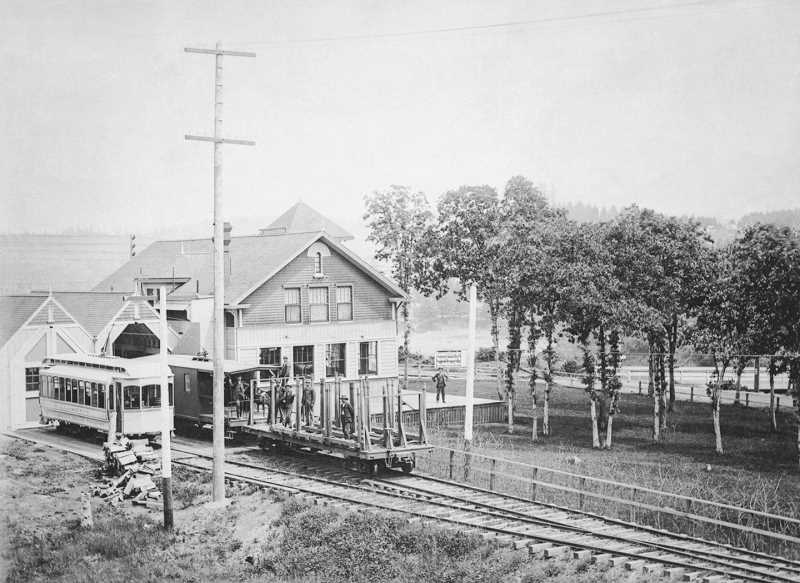 SUBMITTED PHOTO: CLACKAMAS COUNTY HISTORICAL SOCIETY - The old city hall property has long been a focal point along the city's waterfront, and at one point served as both city hall and a train station.