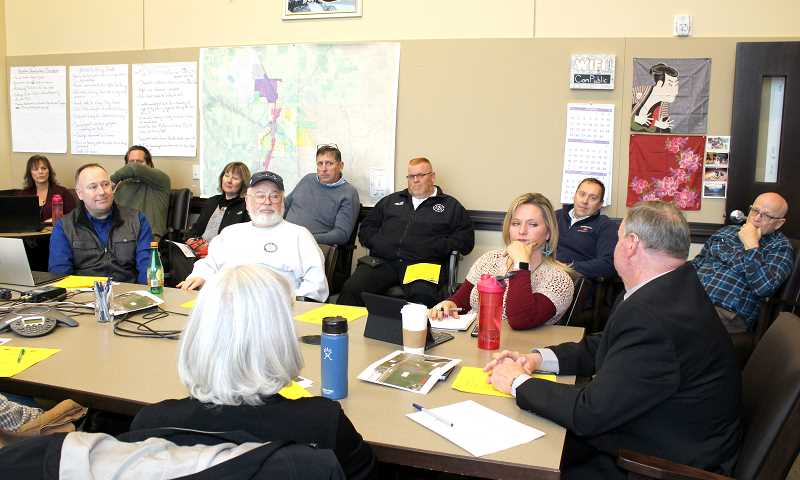 HOLLY M. GILL/MADRAS PIONEER - Members of the Madras City Council and Jefferson County Board of Commissioners, along with Jefferson County Fire District and Emergency Medical Services officials, meet to discuss local issues Nov. 28.