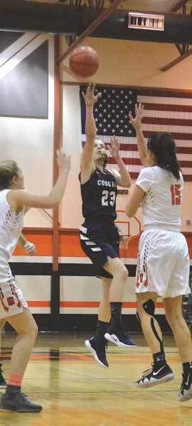 PIONEER PHOTO: TANNER RUSS - Country Christian freshman Lizzy Grandle led the team in the season opener against Molalla with 7 points.