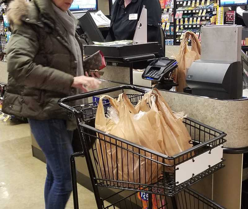 REVIEW PHOTO: GARY M. STEIN - Lake Oswego city councilors voted this week to ban single-use plastic bags (with some exceptions) at most of the city's retailers, restaurants, the farmers market and City-sponsored events.