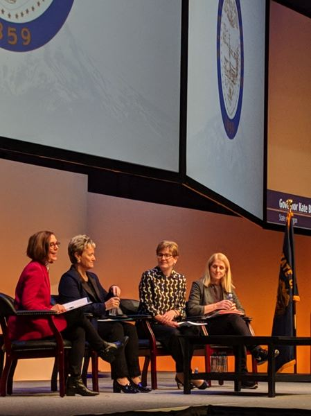 PAMPLIN MEDIA GROUP: JOSEPH GALLIVAN - (L-R) At the Oregon Leadership Summit Monday, Governor Kate Brown, Maria Pope, president and CEO, Portland General Electric; Lisa Vance, EVP, chief executive, Providence Health and Services; and Julia Brim-Edwards, senior director, Global Operations, World Headquarters, Public Engagement, Government and Public Affairs, Nike.