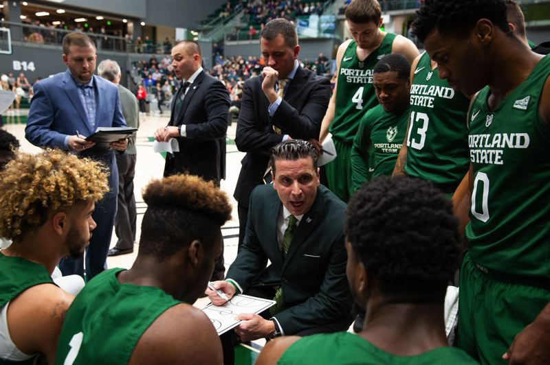 TRIBUNE PHOTO: ADAM WICKHAM - The Portland State Vikings huddle around coach Barret Peery during a timeout in their Wednesday game against the Portland Pilots. The Vikings surged over the final three-quarters of the game to win  87-78 at Viking Pavilion and improve to 5-3.