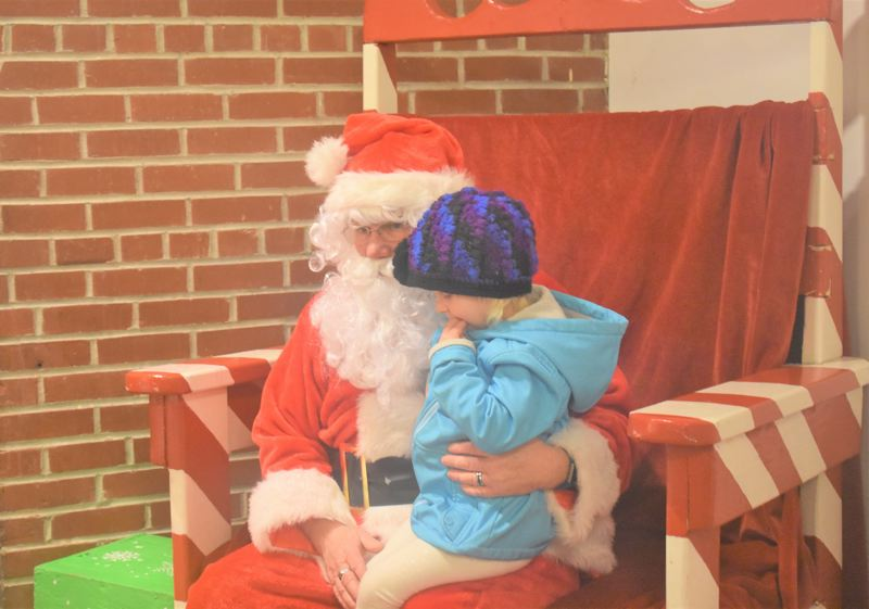 ESTACADA NEWS PHOTO: EMILY LINDSTRAND - Santa visits with a young friend during the annual Estacada Christmas tree lighting on Friday, Nov. 30.