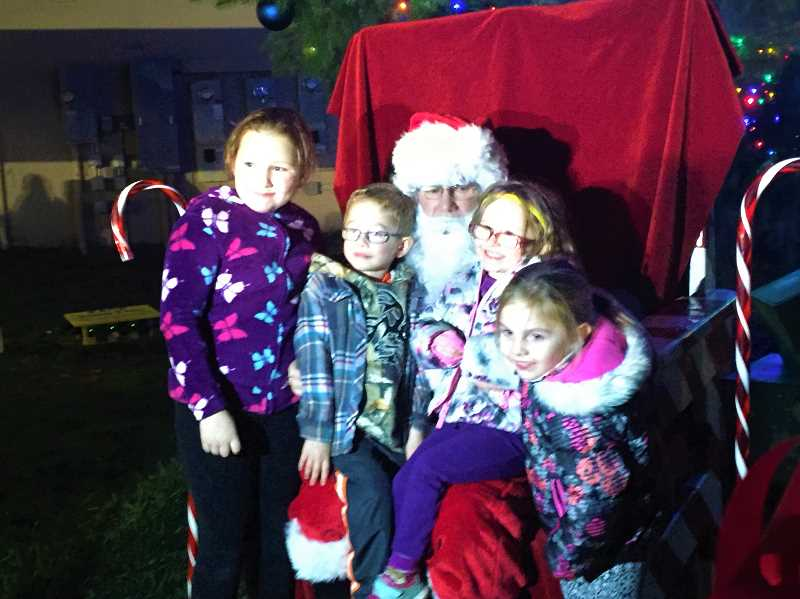 FILE PHOTO - Santa will soon make several appearances in Estacada, including one at Hi-School Pharmacy on Thursday, Dec. 6, another on Dec. 15 at the Fire Station and a third on Dec. 15 at Barton Store.