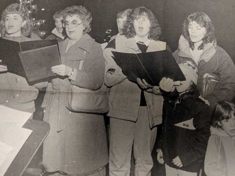 ARCHIVE PHOTO - In 1988, members of the Cascade Christian Chorus led the community in singing Christmas carols at Estacada City Hall.