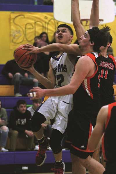 PHIL HAWKINS - Gervais senior Pedro Villegas scored 28 points and hit four 3-pointers in the Cougars' 62-47 loss to the Scio Loggers on Wednesday.