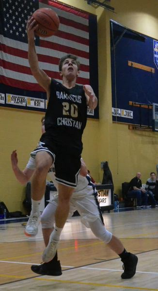 PAMPLIN MEDIA: TANNER RUSS - Damascus Christian guard Johnathan Shields goes up for a layup during the Eagles 64-34 win at Country Christian on Tuesday night.