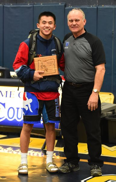 CONTRIBUTED PHOTO: STEPHANIE MATTHEWS - Centennials Phillip Kue was pushed the distance only once on his way to the 126-pound title at last years state tournament. He has signed to wrestle next season at Ohio State University.