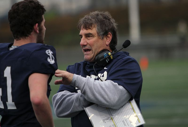 REVIEW PHOTO: MILES VANCE - Lake Oswego football coach Steve Coury talks with senior tight end/linebacker George O'Brien during the Lakers' state championship win on Saturday.