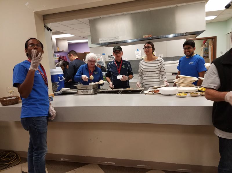 COURTESY PHOTO: CENTRO CULTURAL DE WASHINGTON COUNTY - Volunteers dish up food for guests at last year's Christmas dinner at Centro Cultural.