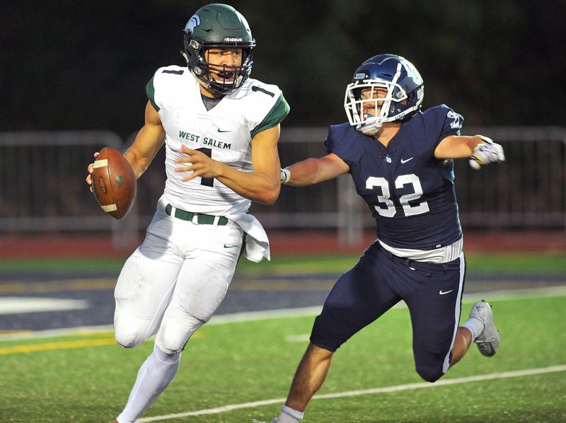 REVIEW FILE PHOTO - Lake Oswego senior linebacker Gabe DeVille chases down West Salem quarterback Simon Thompson in their 48-21 win on Aug. 21.