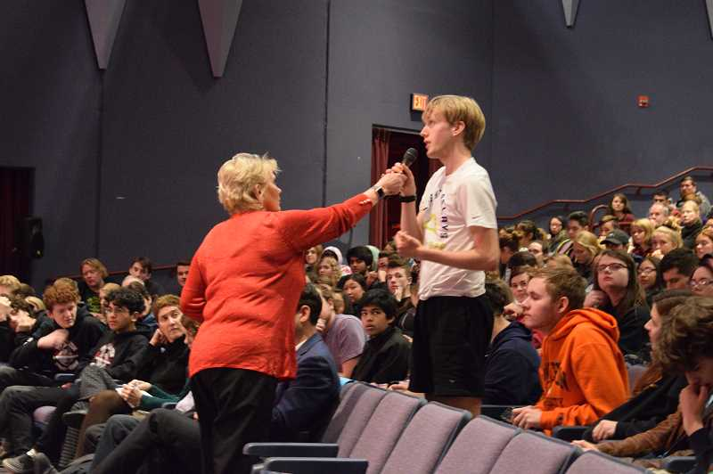 COURTESY OF TUALATIN HIGH SCHOOL YEARBOOK STAFF/TAYLOR WYLAND - A student asks a question during a town hall meeting at Tualatin High School on Dec. 1