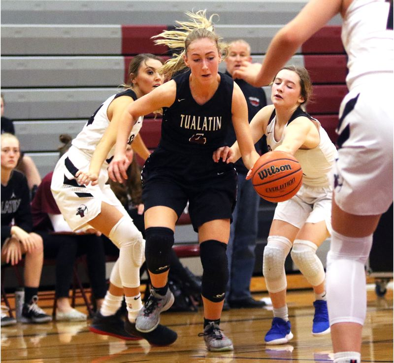 TIMES PHOTO: DAN BROOD - Tualatin senior Natali Denning looks to drive to the basket during the Wolves win at Sherwood on Tuesday.
