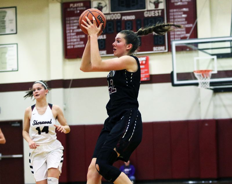 TIMES PHOTO: DAN BROOD - Tualatin sophomore post Natalie Lathrop had 16 points and 19 rebounds for the Wolves in their 41-38 win at Sherwood.